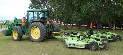 6410 John Deere Tractor and Schulte Brush Mower